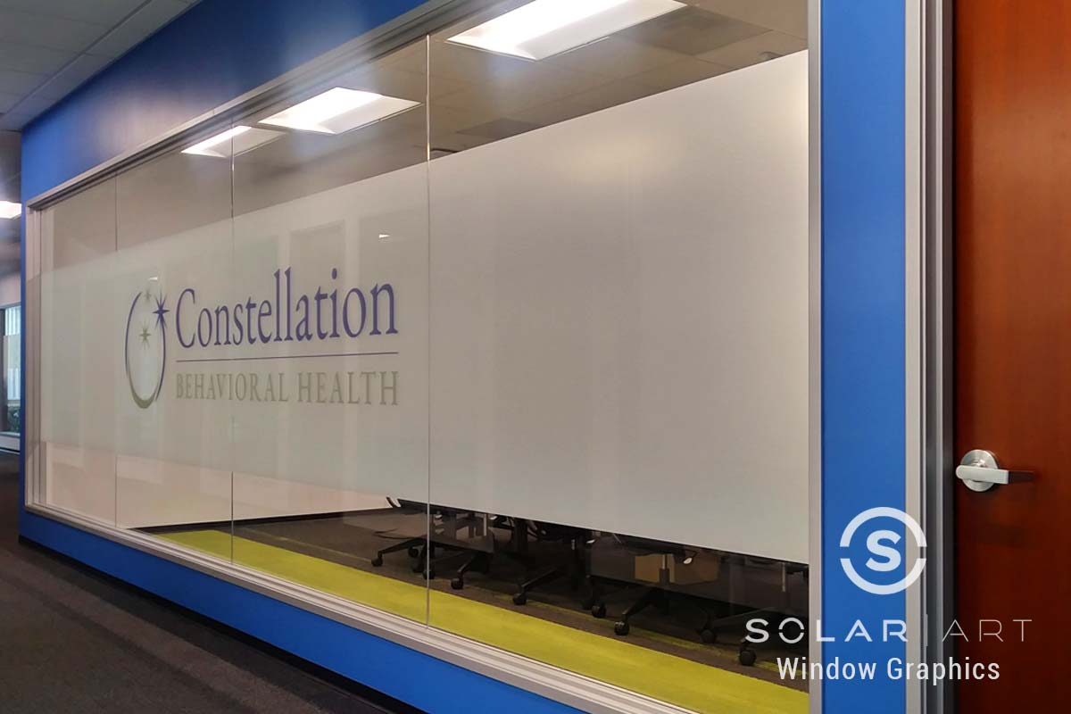 Window graphics with frost and logo