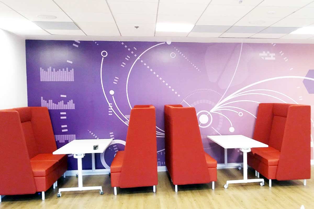 Custom wall graphics on cafeteria walls in office building